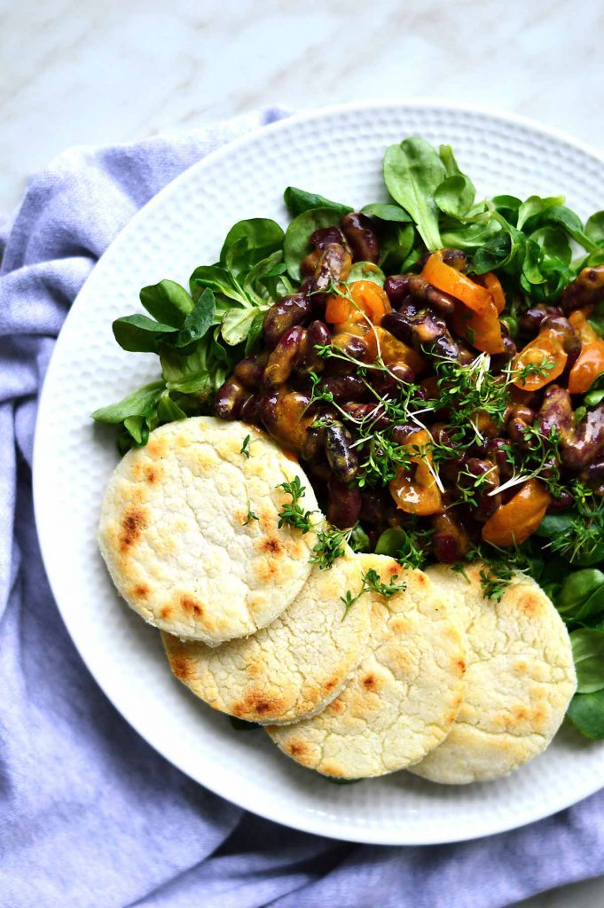 Arepas with beans and salad