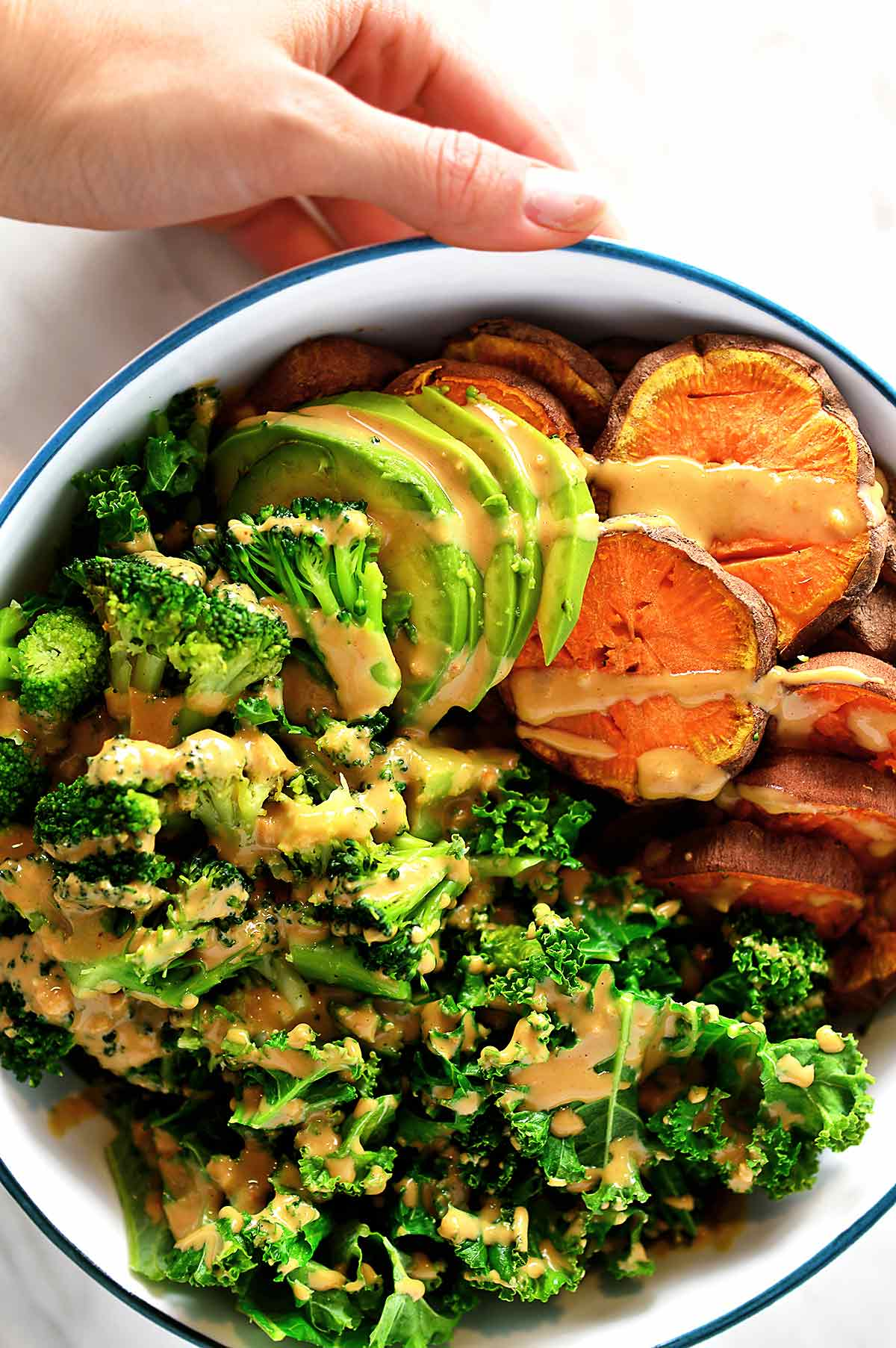 Bowl with sweet potatoes, broccoli and kale