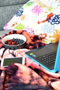 porridge, cell phone and laptop on a sofa