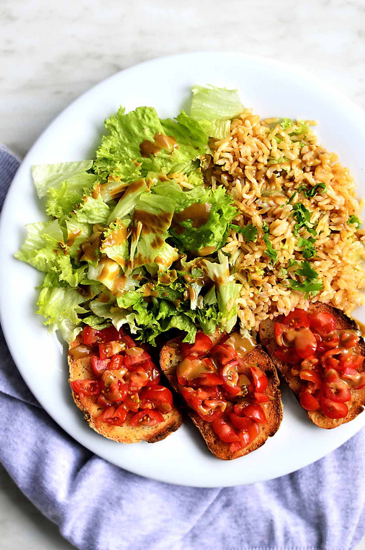 Rice, salad and tomatoes on toast