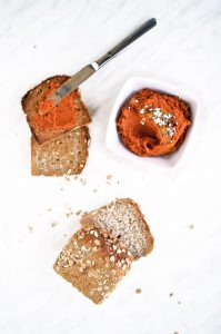 Roasted red bell pepper hummus on bread