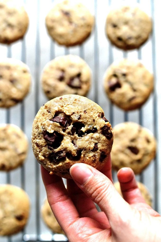 holding the best soft vegan chocolate chip cookies