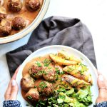 vegan meatballs casserole and a plate with vegan meatballs, fries and salad