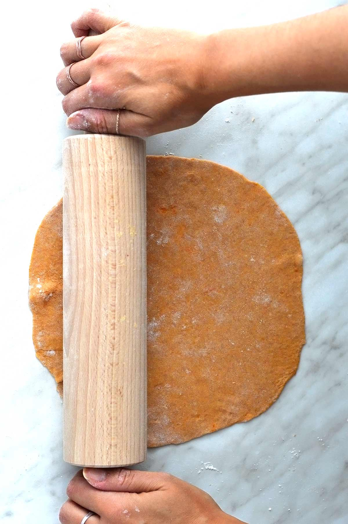rolling sweet potato tortillas dough