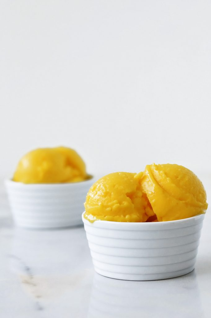homemade mango ice cream in a white bowl