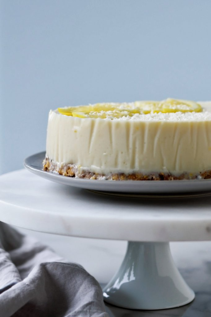 lemon and yogurt pie on a marble pedestal