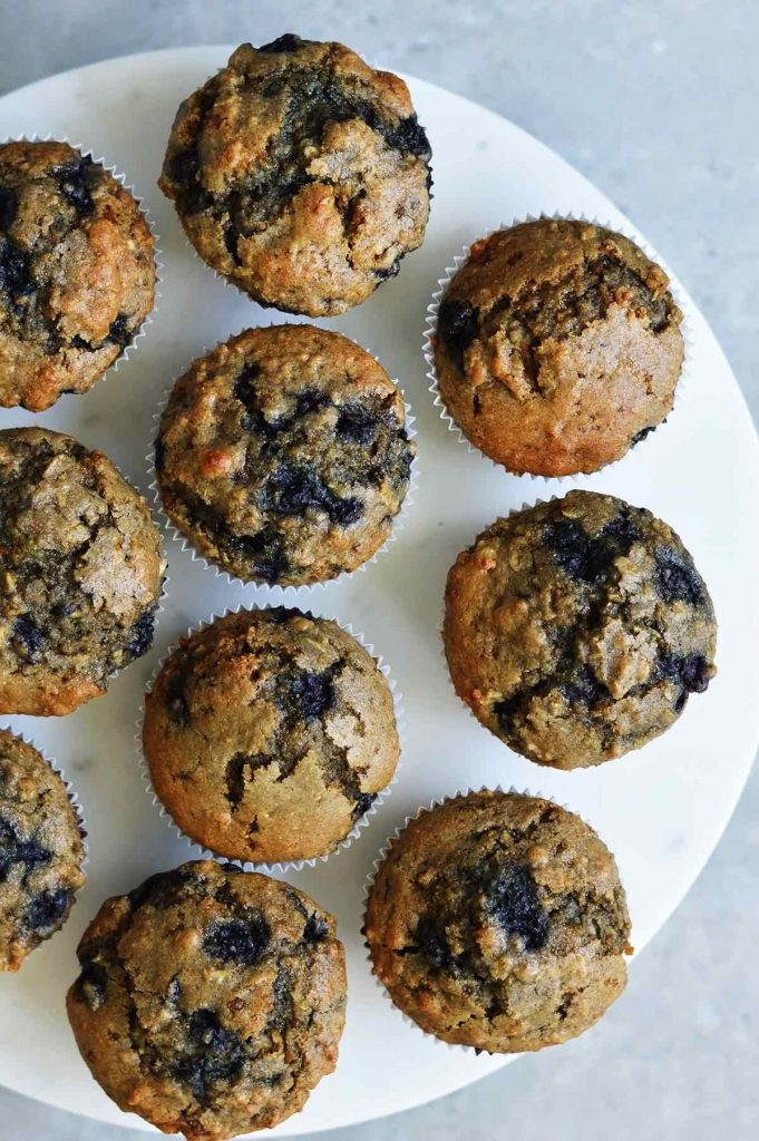 began blueberry oatmeal muffins on a marble plate