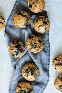 began blueberry oatmeal muffins on a grey board