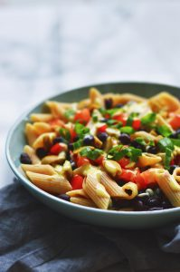 vegan pasta salad in a blue plate