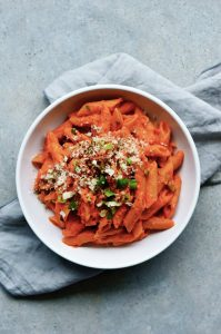 roasted pepper pasta in a white bowl