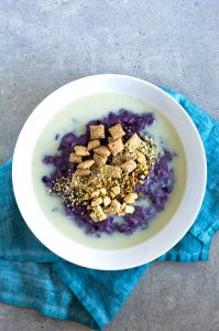 blueberry and yogurt porridge with toppings